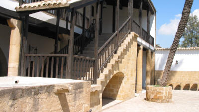 The courtyard and stairs to the wooden veranda at the Lusignan house, Nicosia, North Cyprus