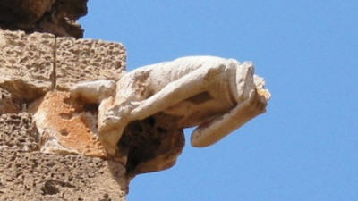 A gargoyle in the forfm of a monk